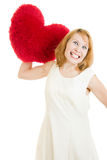 Wicked girl throws a heart Stock Images