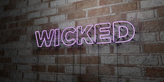 WICKED - Glowing Neon Sign on stonework wall - 3D rendered royalty free stock illustration. Can be used for online banner ads and direct mailers Royalty Free Stock Image