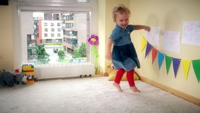 Wicked kid at home. Active girl run jump and dance with energy