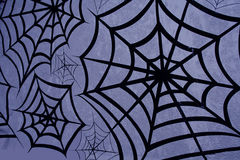 Wicked Web. Black spider webs with a purple background Stock Photography