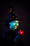 Wicked witch with apple Royalty Free Stock Image