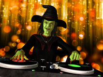 Wicked Witch DJ. A wicked witch is in the house and mixing up some Halloween horror.  Turntables with vinyl albums Royalty Free Stock Image