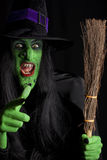 The wicked witch and her broomstick. Royalty Free Stock Image
