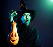 Wicked witch with pumpkin Lantern Stock Images
