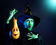 Wicked witch with pumpkin Lantern Royalty Free Stock Image