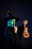 Wicked witch with pumpkin Lantern royalty free stock photography