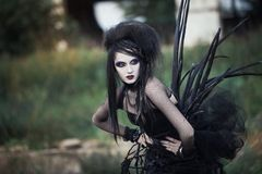 Wicked witch woman in a dark forest royalty free stock photo