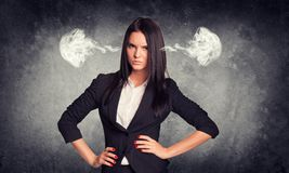 Wicked woman with steam from ears. Concrete gray Royalty Free Stock Image