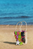 Wicker bag on the beach Royalty Free Stock Images