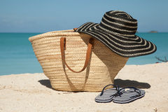 Wicker bag hat and flip flops Stock Photography