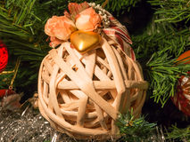 Wicker ball decoration with golden heart and roses on christmas Royalty Free Stock Photo