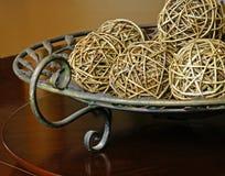 Wicker balls. Home decor wicker balls on platter Royalty Free Stock Image