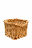 Wicker basket isolated on a white background. An empty wicker basket isolated on a white background Royalty Free Stock Images