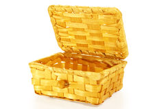 Wicker basket. Outdoor wicker basket of straw. On a white background royalty free stock photos