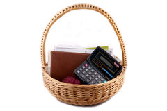 Wicker basket. With housewives everyday things on white stock images