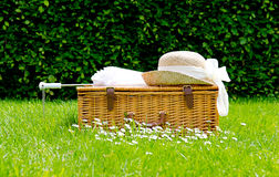Wicker basket. Umbrella and sun hat Royalty Free Stock Image