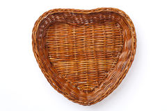 Wicker Basket. A heart-shaped basket  on a white background Royalty Free Stock Photos