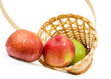 Wicker basket with apples Royalty Free Stock Image