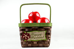 Wicker basket with apples. A wicker basket full of autumn apples Royalty Free Stock Photography
