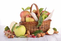 Wicker basket with apples stock images