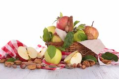 Wicker basket with apples and nuts Royalty Free Stock Photo