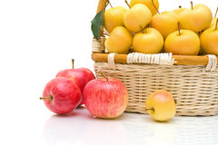 Wicker basket with apples on a white background Stock Image