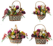Wicker basket with artificial flowers Royalty Free Stock Photos
