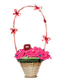 Wicker  basket with artificial flowers Stock Images