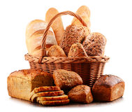 Wicker basket with assorted baking products on white Royalty Free Stock Photos