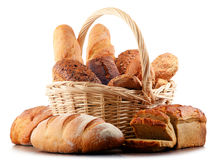 Wicker basket with assorted baking products on white Royalty Free Stock Images