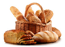 Wicker basket with assorted baking products on white Stock Photography