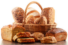 Wicker basket with assorted baking products on white Stock Photo