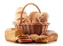 Wicker basket with assorted baking products on white Royalty Free Stock Image