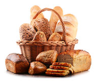 Wicker basket with assorted baking products on white Stock Images