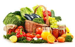 Wicker basket with assorted organic vegetables and fruits Royalty Free Stock Images
