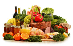 Wicker basket with assorted organic vegetables and fruits Royalty Free Stock Photos