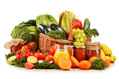 Wicker basket with assorted organic vegetables and fruits Stock Photo