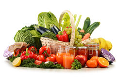 Wicker basket with assorted organic vegetables and fruits Stock Photos