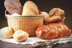 Wicker basket with assortment of baked bread Royalty Free Stock Images