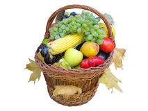 Wicker basket with autumn fruit and vegetables Stock Photo