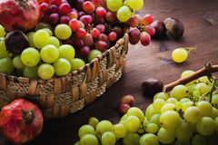 Wicker basket with autumn fruits Stock Photo