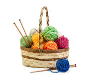 Wicker basket with balls of yarn Royalty Free Stock Photo