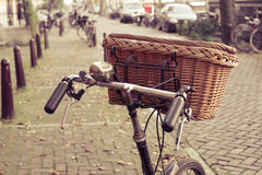 Wicker basket on a bicycle Stock Image
