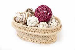 Wicker basket with bits a pieces. Wicker basket with a lot of trinkets on a white background stock photos