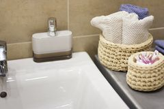 Wicker basket with blue and white towel royalty free stock photography