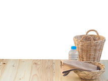 Wicker basket, bottle and fabric and fabric on wooden terrace pine. Stock Image
