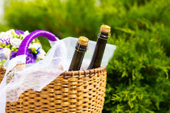 Wicker basket with bottles Royalty Free Stock Photos