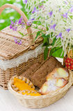 wicker basket and a bouquet of field flowers Royalty Free Stock Images