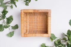 Wicker Basket with Branches Flat Lay Top View. A Wicker Basket with Branches Flat Lay Top View Royalty Free Stock Images
