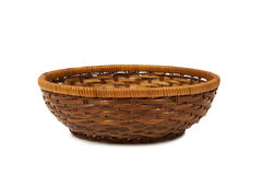 Wicker basket of bread or fruit. On a white background Royalty Free Stock Photography